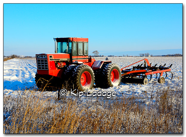 Snowy International Harvester Tractor in Field - Image 288354