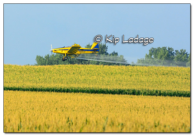 Crop Duster Spraying Field - Image 389878