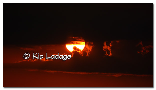 Sunrise Through Clouds - Image 465669 (© Kip Ladage)