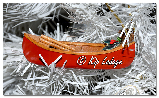 Red Canoe Christmas Decoration - Image 536736 (© Kip Ladage)