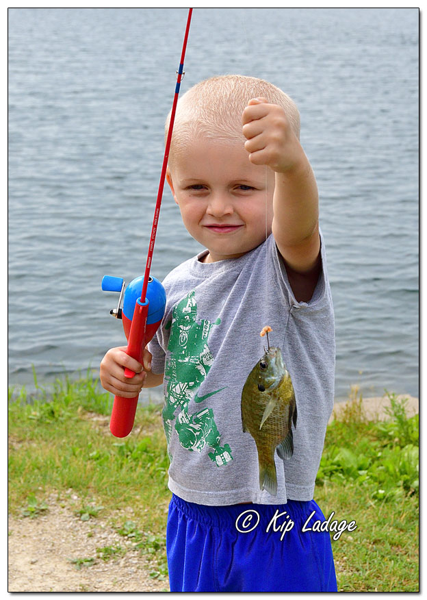 Grandson with Bluegill - Image 641030 (© Kip Ladage)